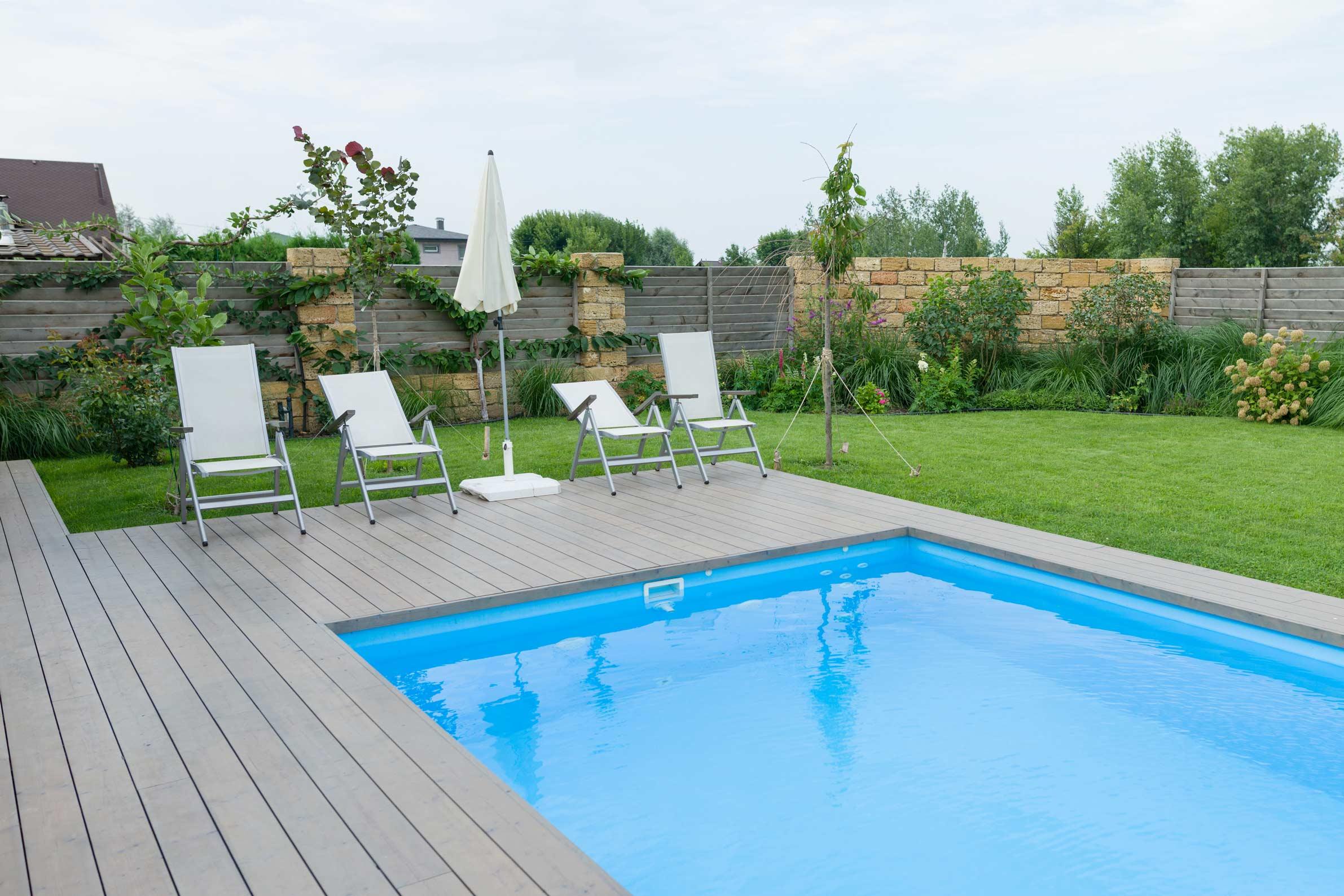 grey deck pool backyard