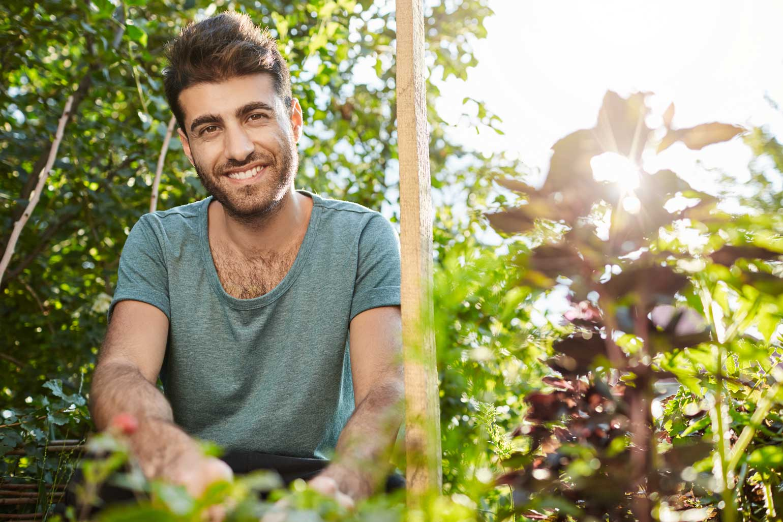 man planting vegetables